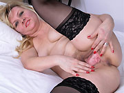 Horny blonde in stockings shows a hairy pussy