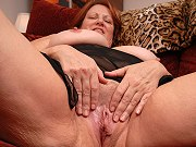 Redheaded fat mature Brandy spreading pussy and showing her big boobs