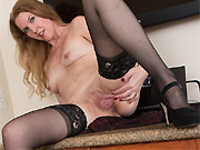 Lacy F long-legged milf blonde poses in black stockings