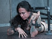 Henna Hex hot tattoo babe suffering in metal bondage in dungeon