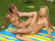Lesbian babes get juicy and have dildo sex outside