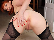 Red XXX in black stockings shows a striptease