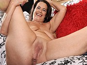 Naughty mature plumper Tia getting naked and spreading pussy on couch
