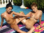 Shaved lesbian babes have loving dildo sex outside