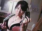 Cute Asian girlfriend taking erotic selfies