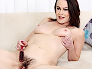 Brunette milf shows her hairy pussy and how to brush it with a comb