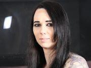 Stunning tattooed shemale Sabina Sinn shows off her purple bustier