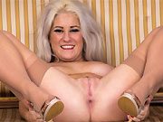 Lu Elissa busty mature blonde in stockings strips on a couch