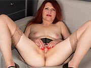Cee Cee redhead mom in lingerie and stockings strips on sofa