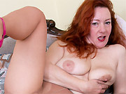 Jessica OHare busty redhead mom in pantyhose strips on couch