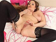 Sophia Delane busty milf beauty in stockings stripping