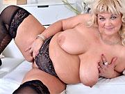 Bigboobs mature blonde in black stockings stripping