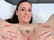 Melanie Hicks busty milf hottie shows pussy on a bed
