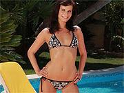 Pretty eyes bikini babe by the pool