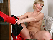 Mature lady in boots reveals fuzzy pussy