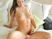 Pretty masturbating brunette on the couch