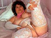 Juicy mature fatty in white lingerie showing her big boobs and pussy