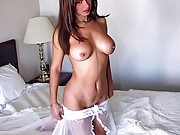 Pretty girl with a killer body and big tits strips on the bed