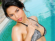 Bikini strip teasing Asian beauty by the pool
