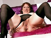 Fat big tits mature in stockings getting naked and spreading her pussy