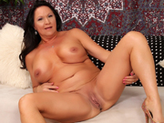 Horny milf gets naked and open her legs wide to show her mature pussy