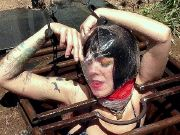 Abigail Dupree is outdoors dominated and bound in a hole for sex
