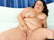 Chubby milf gets naked and spread her meaty pussy for better view