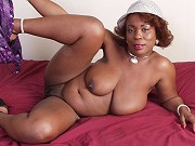 Big tits ebony plumper Yvette getting naked and playing with red dildo