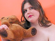 Fat brunette teen getting nasty and playing with a teddy bear on bed