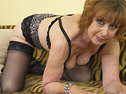 Amateur mom in black stockings stripping on sofa