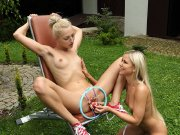 Blond lesbians spread and toy shaved pussy outside