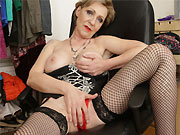 Busty mature blonde in black fishnet stockings toying