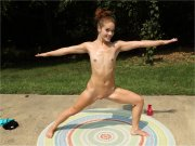 Brunette teen in a naked workout outdoors