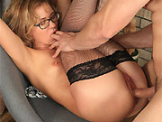 Lisa Young in black stockings fucking in an armchair