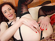Scarlet Martini curly milf in black stockings toying