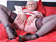 Amateur mature blonde poses in lingerie and stockings