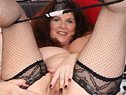 Gilly Sampson busty mature posing in black stockings