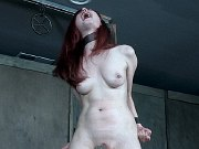 Penny Lay redhead in purple dress bound for spanking by maledom