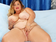 Big titty BBW takes off her clothes and shows off her pussy and tits
