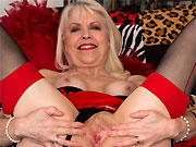 Margaret Holt busty mature blonde poses in black stockings