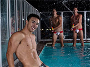 Speedo clad guys hanging out at the pool.