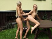 Blonde babe gets rammed with strapon cock outside