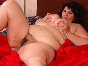 Fat brunette mature Jennifer getting nasty and showing pussy on bed