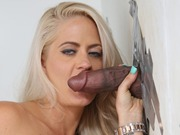 Holly Heart sucking a huge black cock at gloryhole