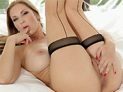 Carol Goldnerova busty blonde in tan stockings posing on bed
