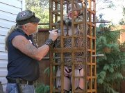 Jessica Kay stockings blonde with red ballgag in a cage outdoors