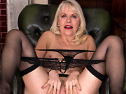 Margaret Holt busty mature in stockings strips in armchair