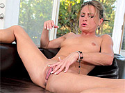 Arousing milf Amanda spreads at home