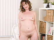 Milf shows her hairy twat at home