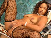 Ebony lady masturbates in sexy stockings